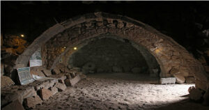 Azraq-Castle-Vaulted-room-In-the-room-are-on-display-a-series-of-carved-stone-reliefs-from-Ayn-As-Sawda-Azraq-al-Shishan-Jordan-Day-Tour-And-More-Desert-Castle-Jordan-Tour-Driver-in-Jordan